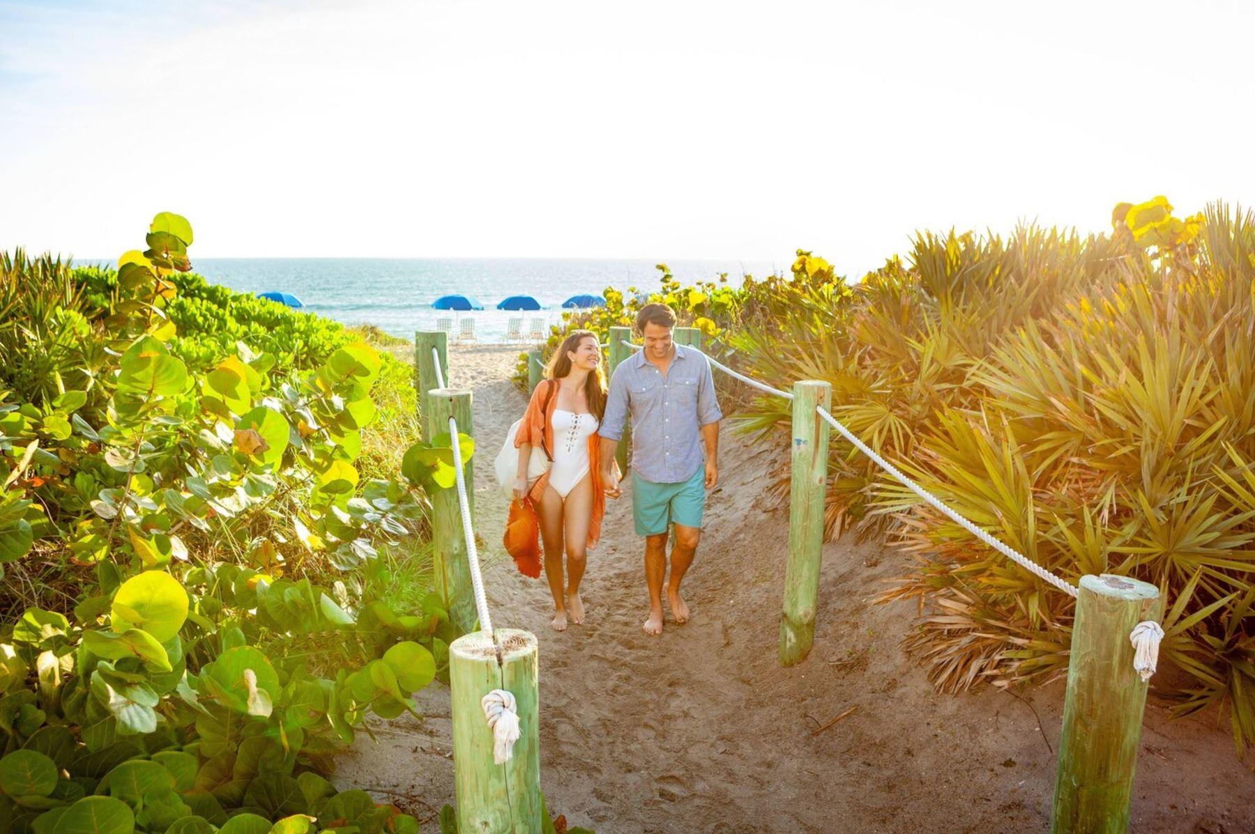 Couple enjoys a romantic walk along the beach on Hutchinson Island