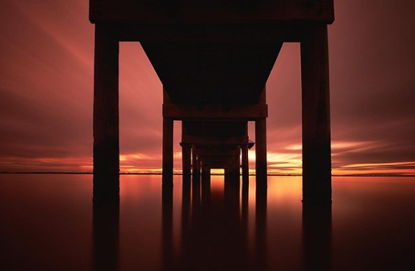 Sunset photograph beneath the docks at the House of Refuge